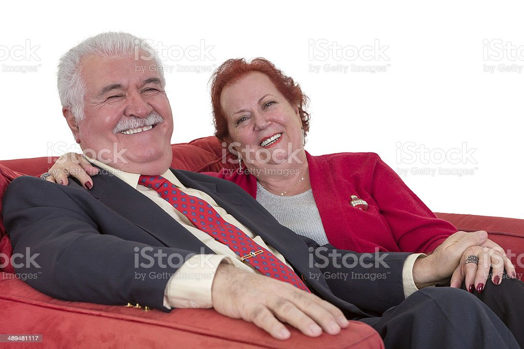 Caucasian senior couple smiling and holding hands royalty-free stock photo