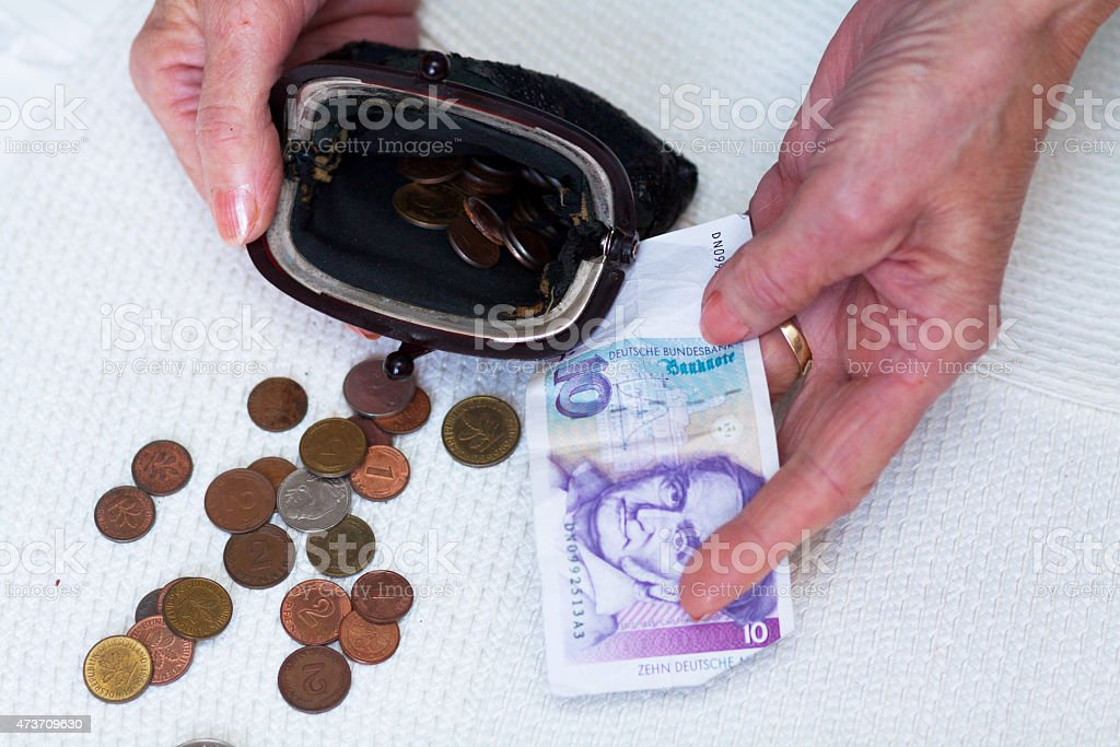 Caucasian senior hands with German currency stock photo