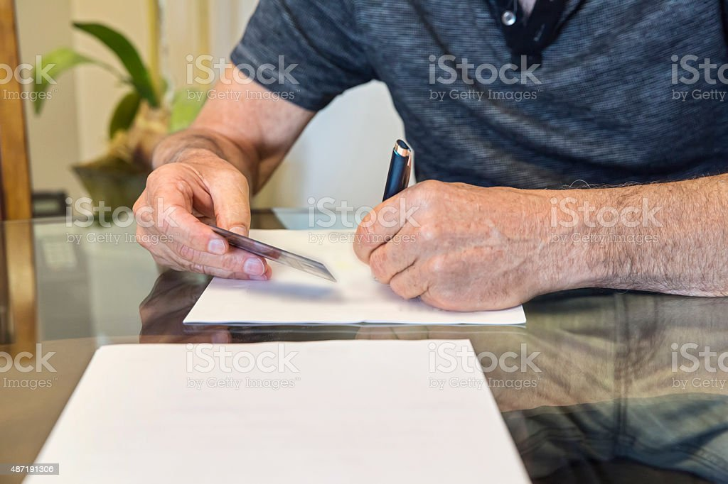 Caucasian senior man at signing of mortgage agreement stock photo