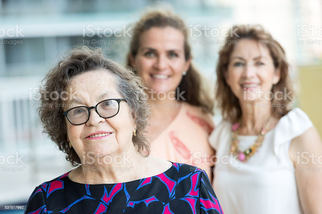 Caucasian Senior mother posing with her mature daughters stock photo