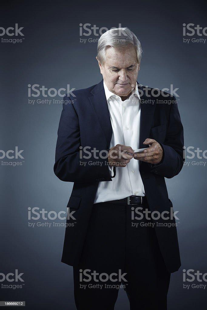 caucasian senior texting stock photo