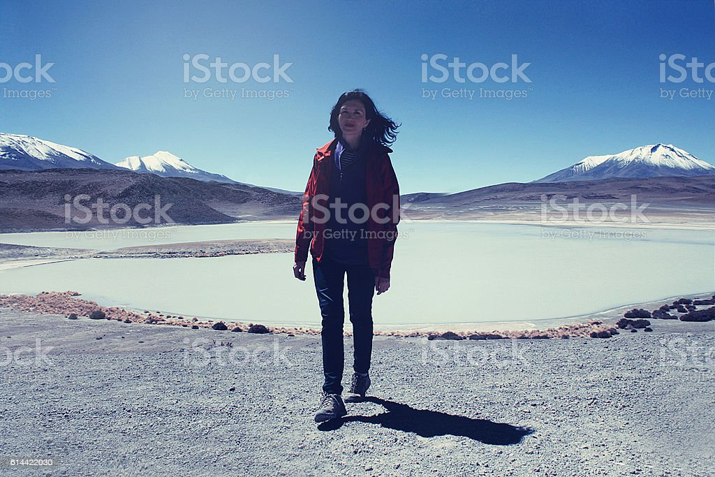 caucasian skinny woman near Lagoon in Andean highlands in Bolivia stock photo