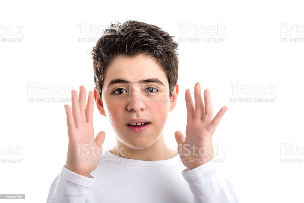 Caucasian smooth-skinned boy waving open hands along face stock photo