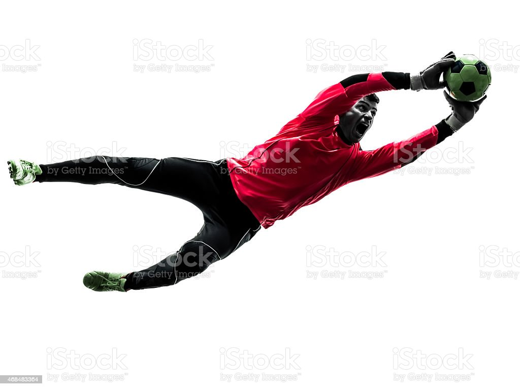 caucasian soccer player goalkeeper man catching ball silhouette stock photo