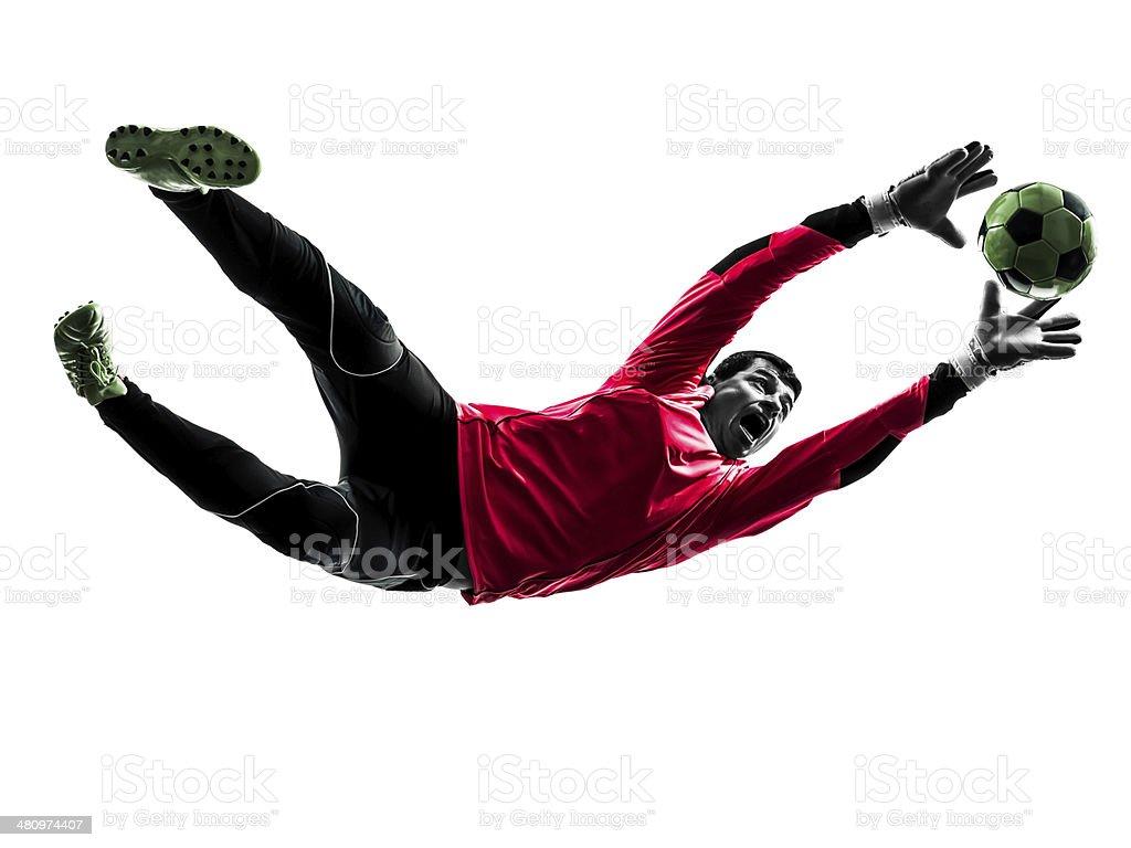 caucasian soccer player goalkeeper man catching ball silhouette stock photo