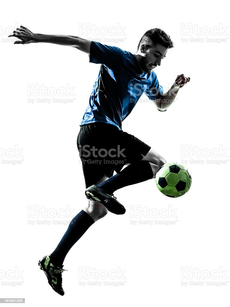 caucasian soccer player man juggling silhouette stock photo