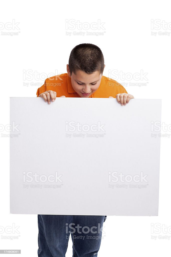 Caucasian teenage boy looking at a blank sign royalty-free stock photo