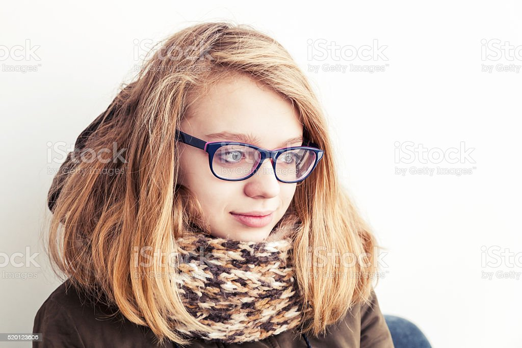 Caucasian teenage girl in glasses and warm scarf stock photo