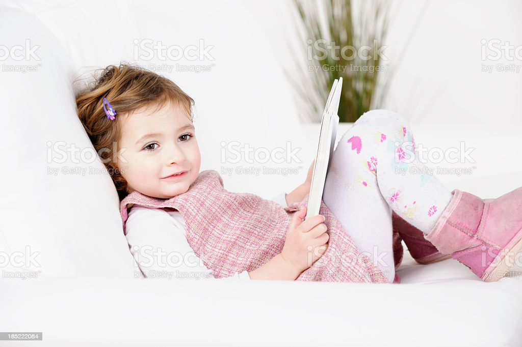 Caucasian Toddler/ Little Girl  Relaxing On The Sofa/ Couch royalty-free stock photo