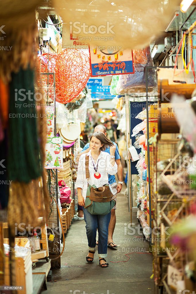 Caucasian tourist couple on Chatuchak market stock photo