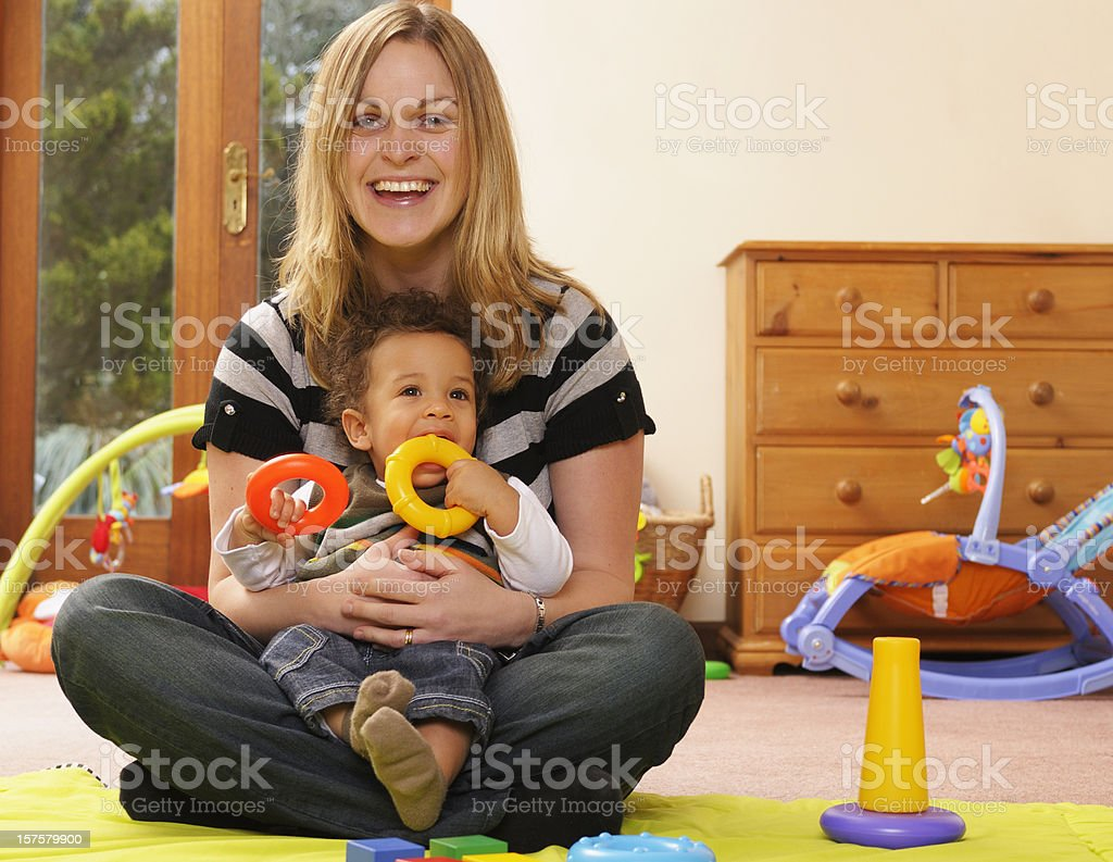 Caucasian Woman And Baby At Playtime stock photo