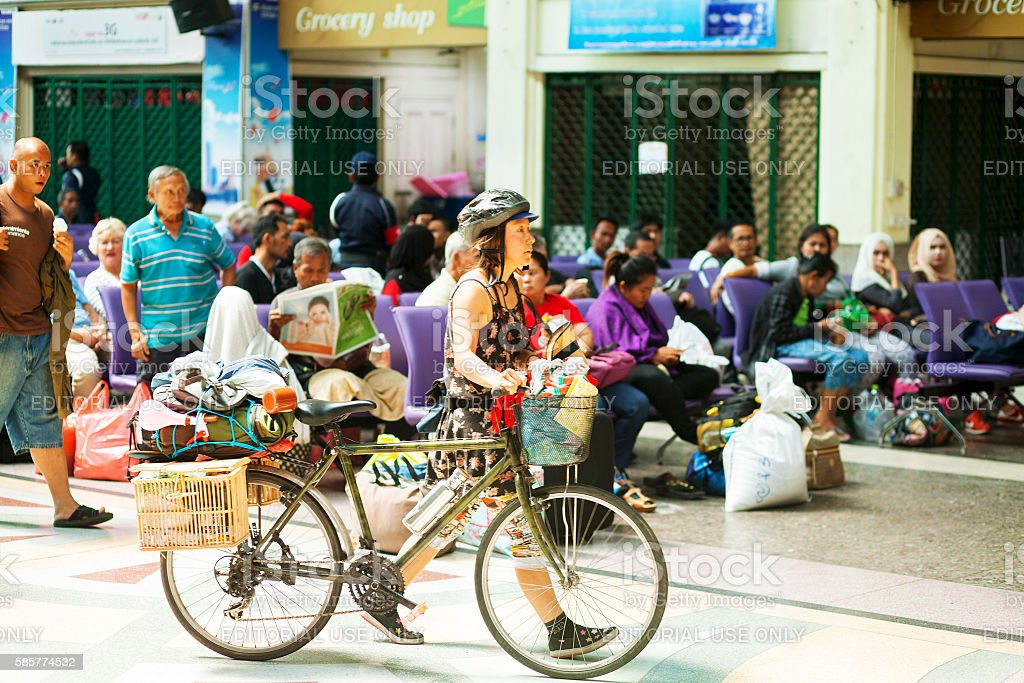Caucasian woman and tourist with bicycle in Hua Lumphong stock photo