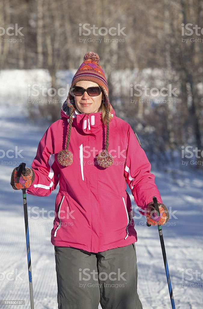Caucasian Woman Cross-Country Skiing royalty-free stock photo
