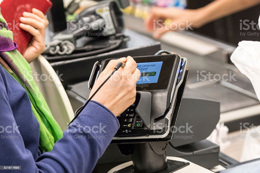 Caucasian woman electronic signing her bill stock photo