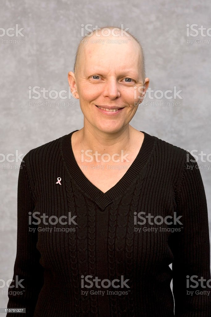 Caucasian woman fighting breast cancer smiling at camera. royalty-free stock photo