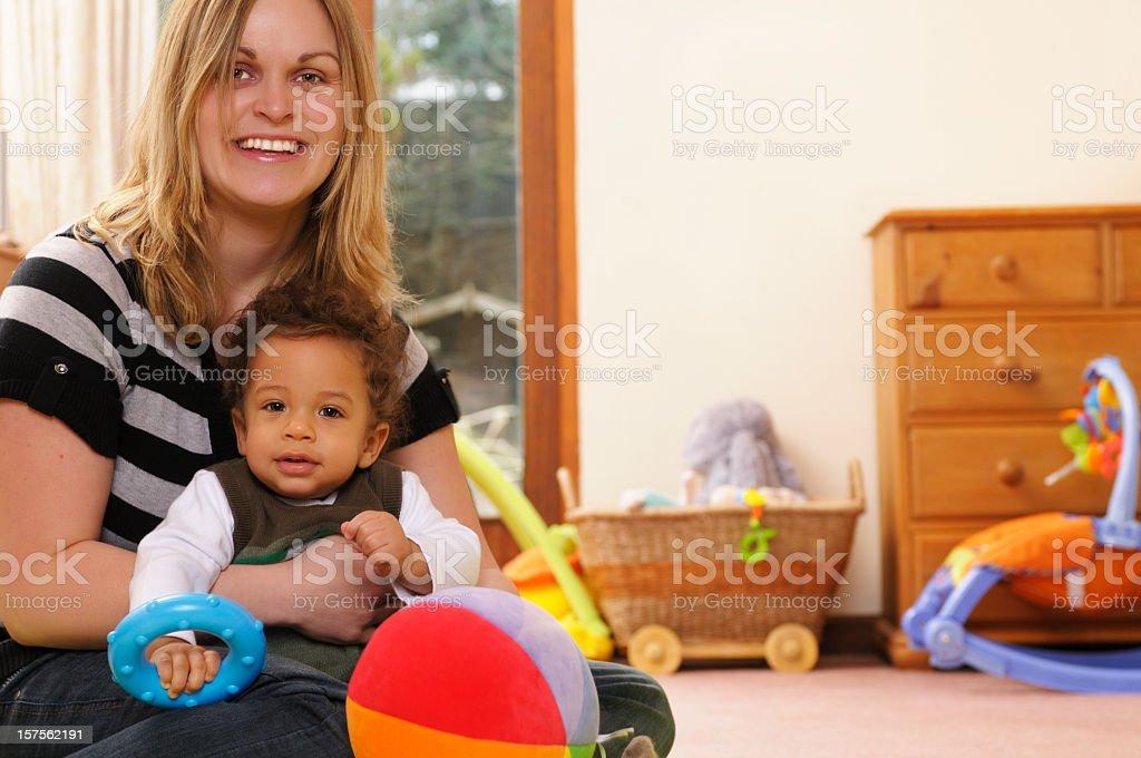 Caucasian Woman Holding Mixed Race Baby stock photo