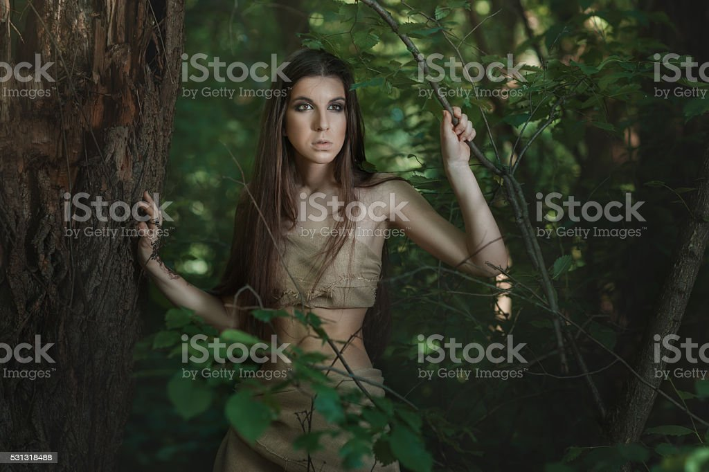 Caucasian woman in the woods. stock photo