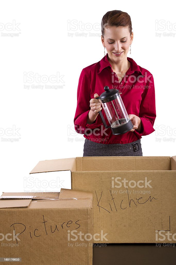 Caucasian Woman Packing Stuff in Moving Boxes stock photo