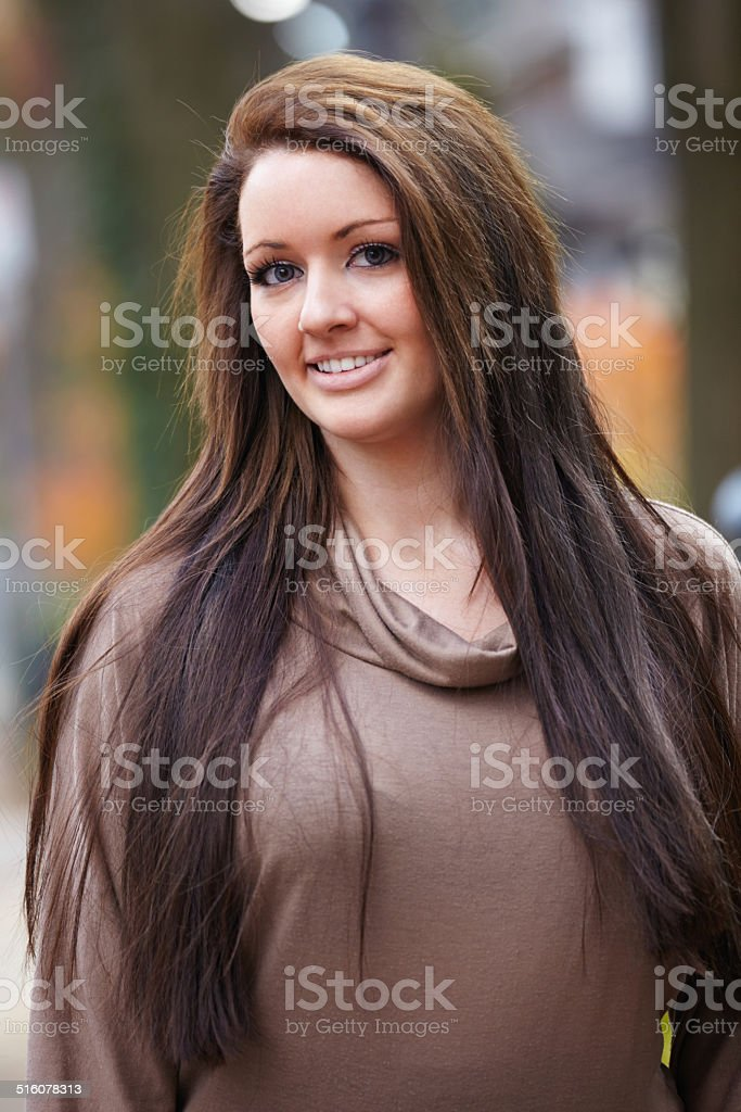 Caucasian woman portrait outdoors smiling stock photo