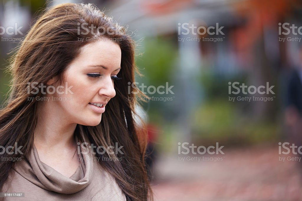 Caucasian woman portrait side profile looking down stock photo