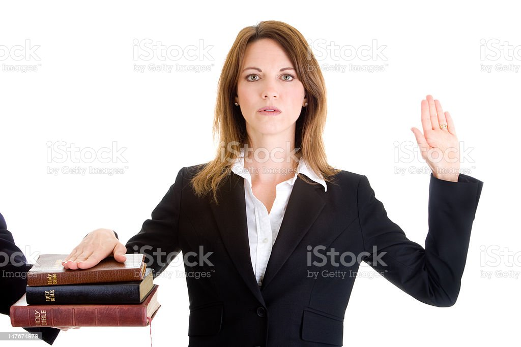 Caucasian Woman Swearing on a Stack of Bibles White Background royalty-free stock photo