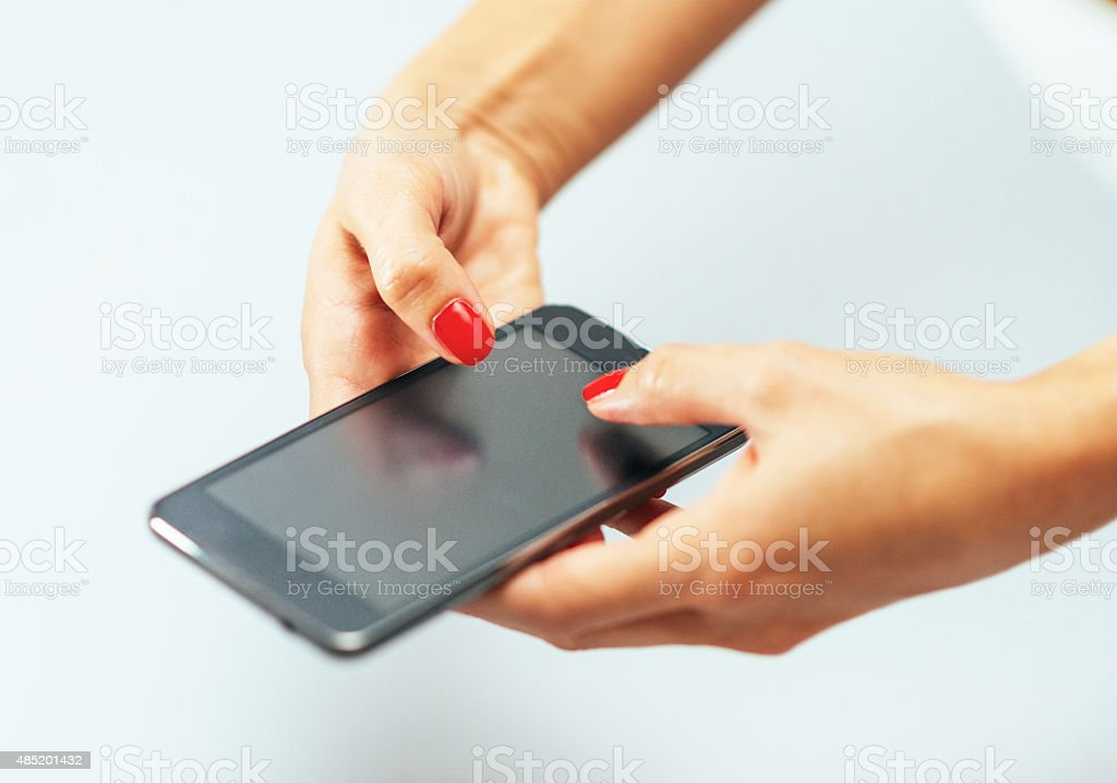Caucasian woman using smartphone for social networking and communication stock photo