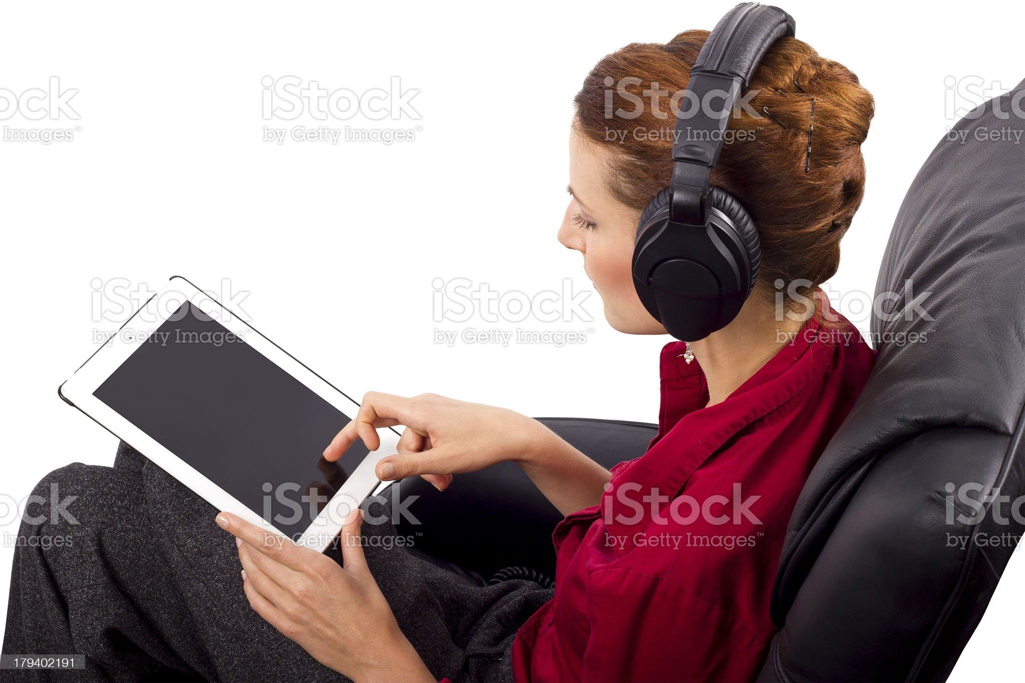 Caucasian Woman Wearing Headphones and Streaming on Mobile Device royalty-free stock photo