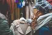 Caucasian Women Buying Cardigan at Christmas Market, Carinthia, Austria
