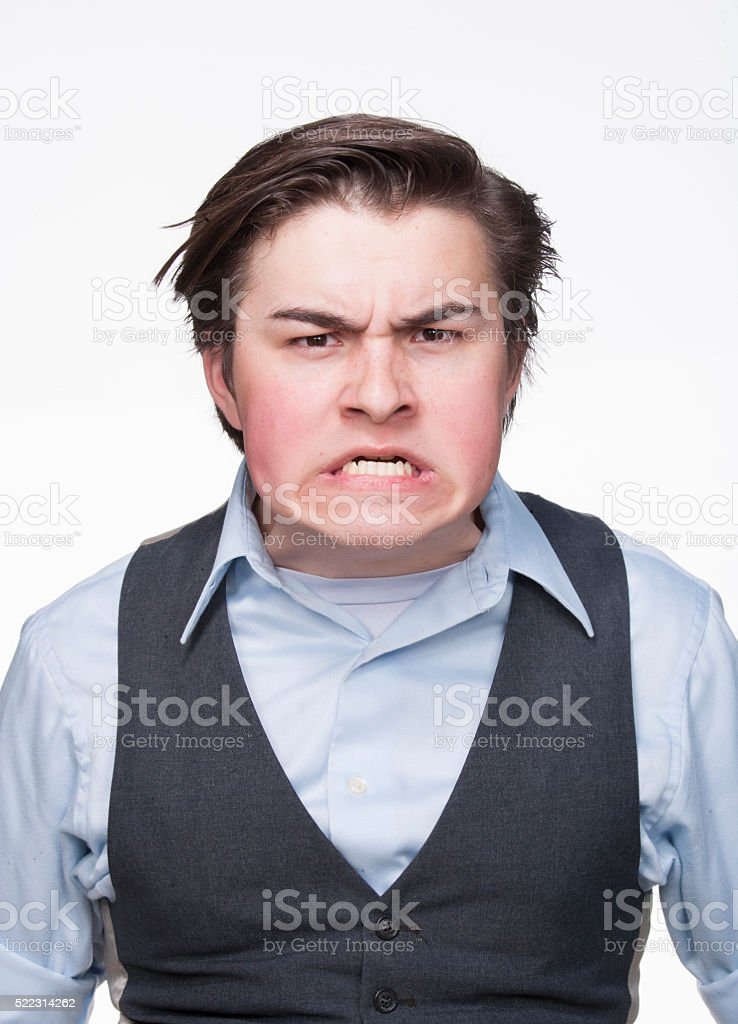 Caucasian young man making a face stock photo