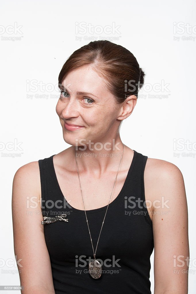 Caucasian young woman looking coy stock photo