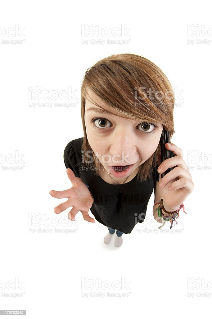 Caucasion Teenage Girl Talking on Phone Cartoon Like Fisheye Effect royalty-free stock photo