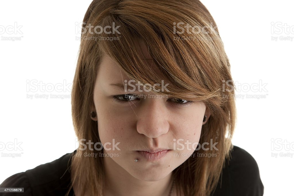 Caucasion Teenage Girl with Piercing is Angry Closeup Headshot stock photo