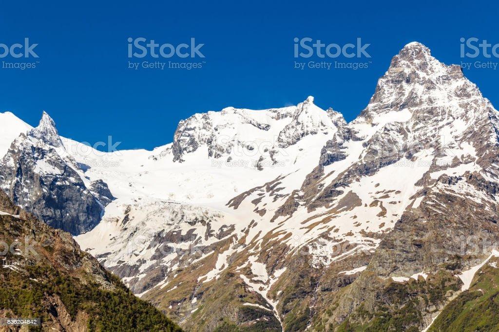 Caucasus mountains under snow stock photo