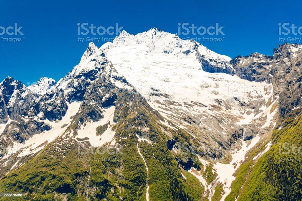 Caucasus rockies with blue sky stock photo