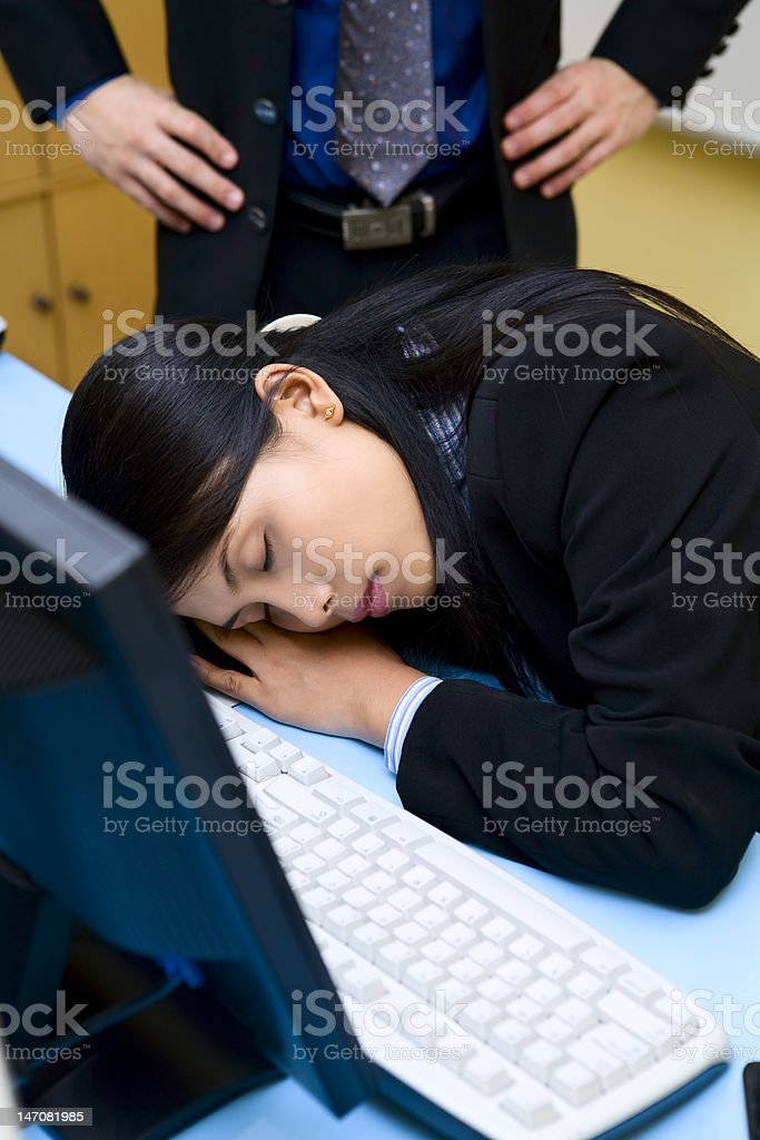 Caught up sleeping in office royalty-free stock photo