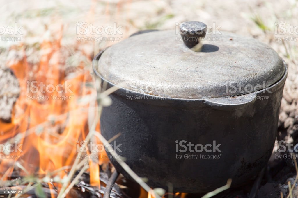 cauldron on the fire on the nature stock photo