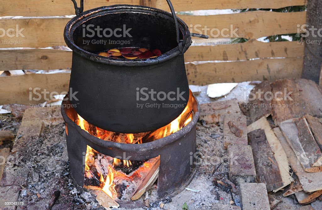 cauldron to cook the tasty mulled wine stock photo