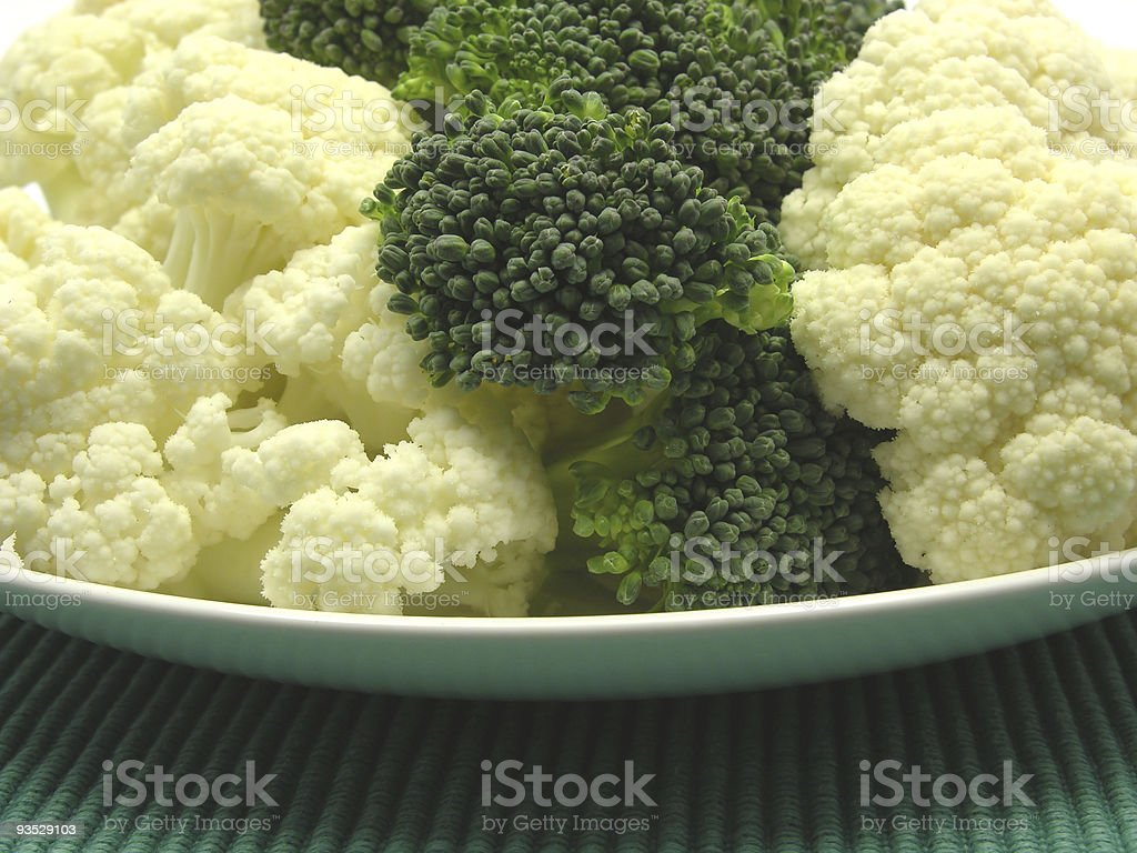 Cauliflower and broccoli arranged on plate royalty-free stock photo