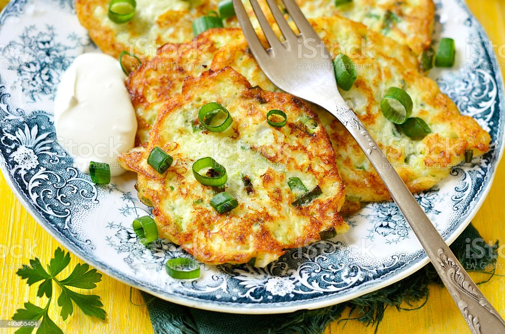 Cauliflower and broccoli fritters with cheese. stock photo