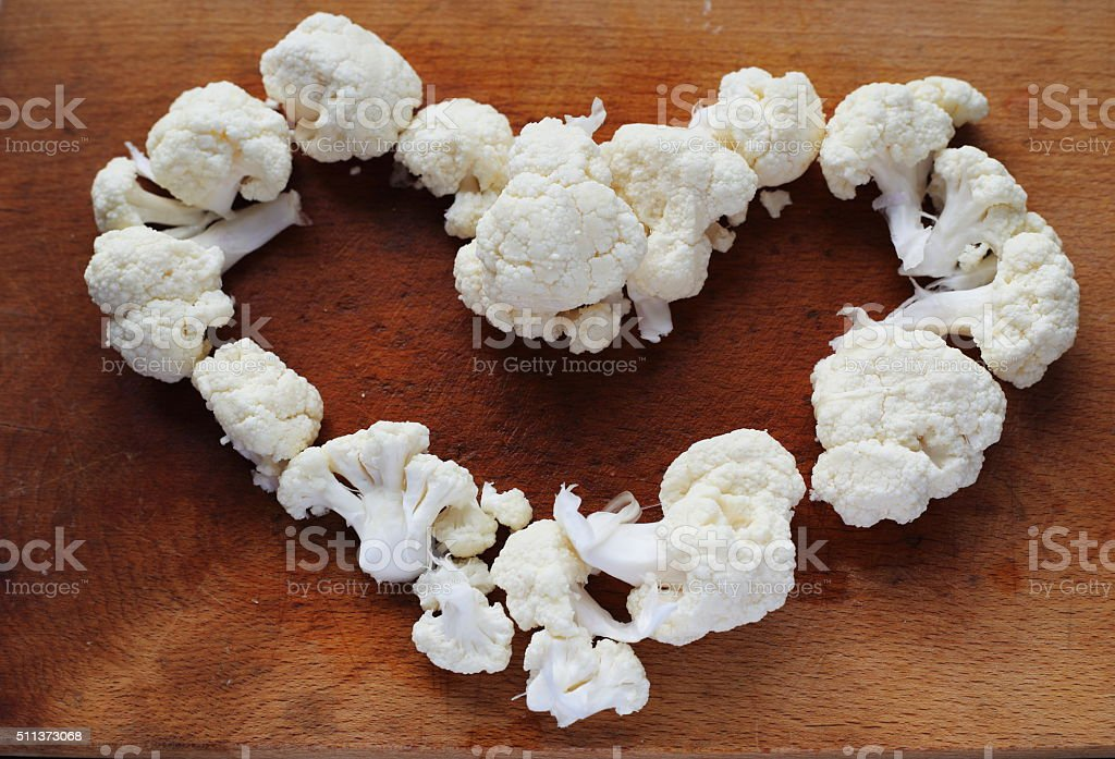 cauliflower heart on wooden table royalty-free stock photo