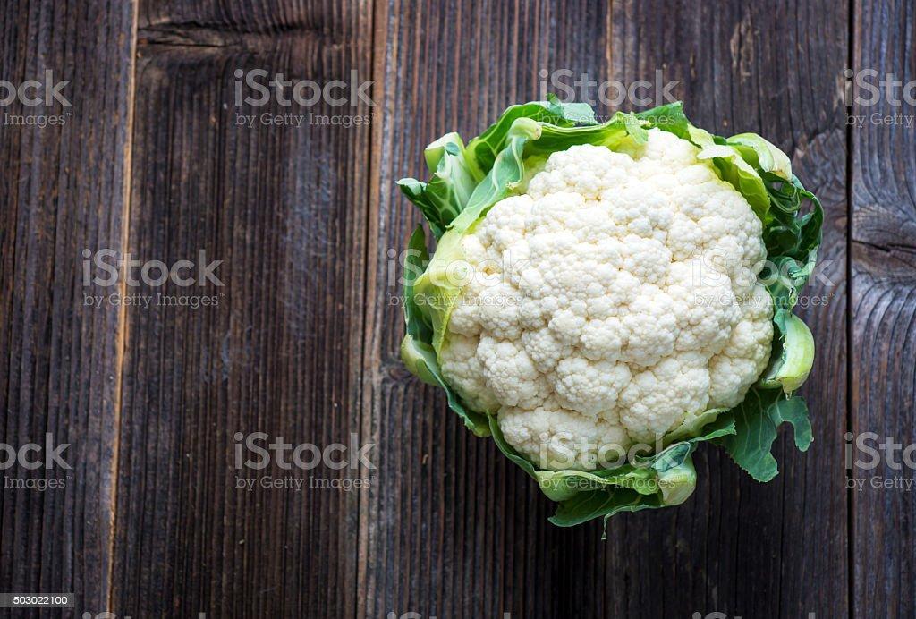 Cauliflower on wooden background stock photo