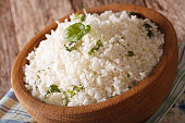 Cauliflower rice with basil in a bowl close-up. horizontal
