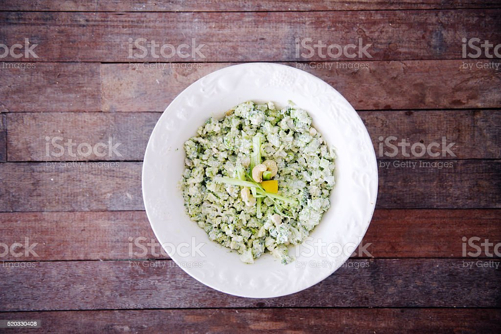 Cauliflower Rice with Cashews and Lemon stock photo