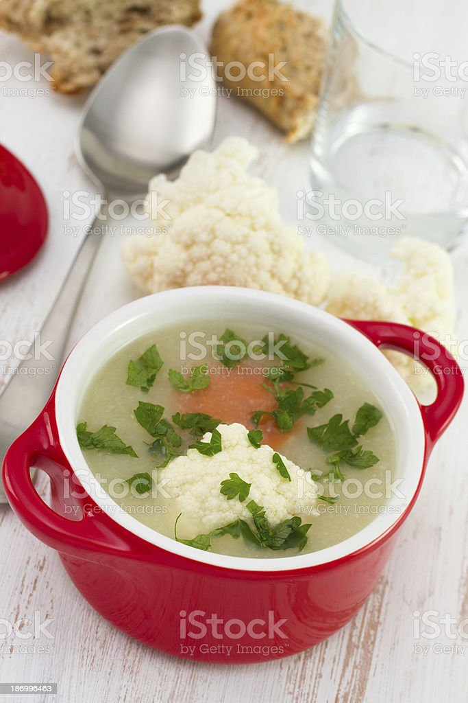 cauliflower soup with carrot and parsley in the red bowl royalty-free stock photo