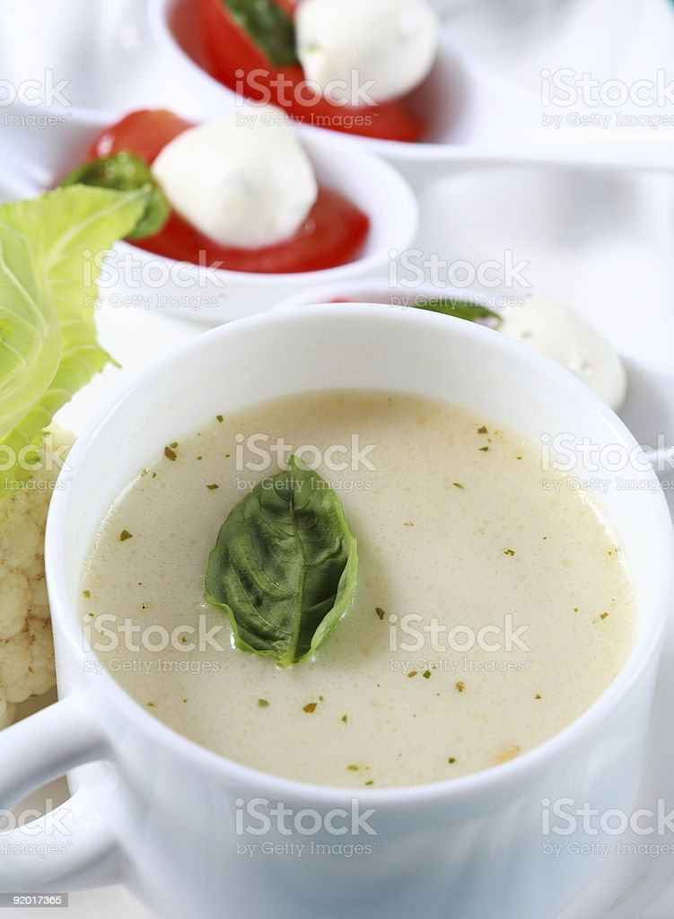 Cauliflower soup with fresh basil royalty-free stock photo