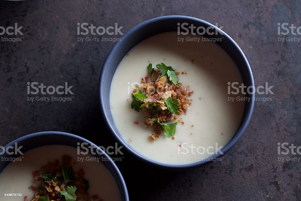 Cauliflower Soup with Sourdough Crumbs, Bacon & Parsley stock photo
