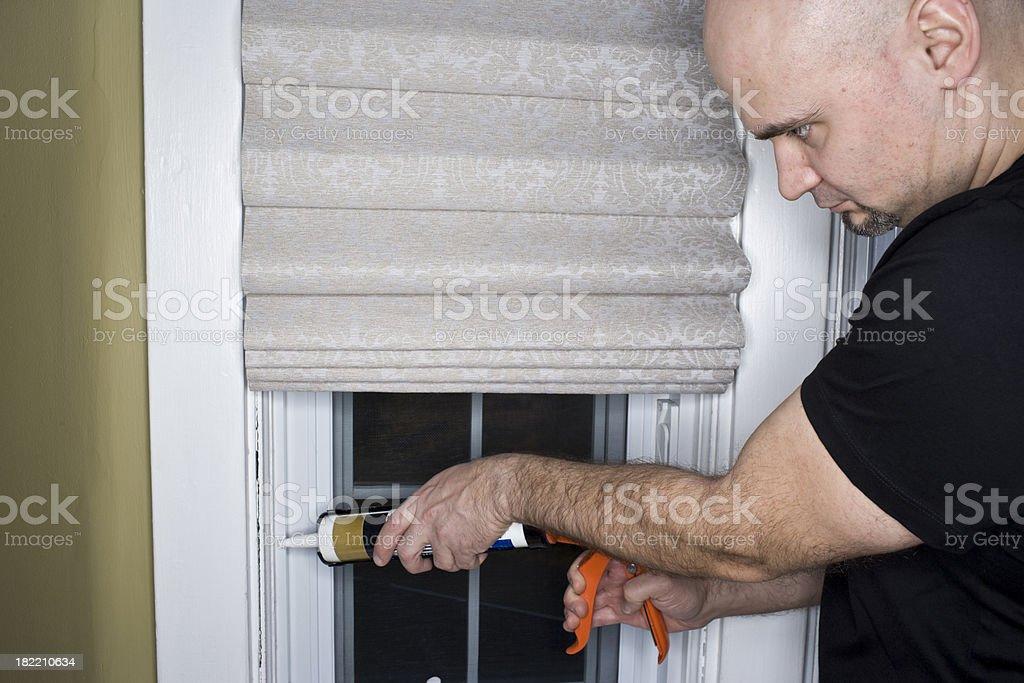 Caulk Gun for insulation stock photo