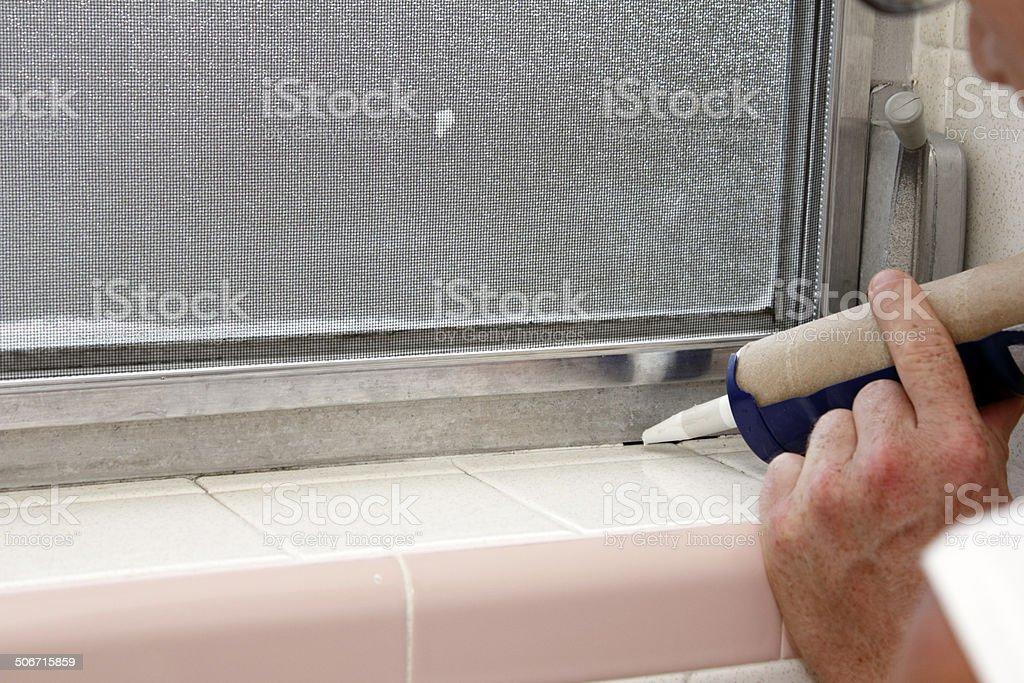 Caulking a Bathroom Window Frame stock photo