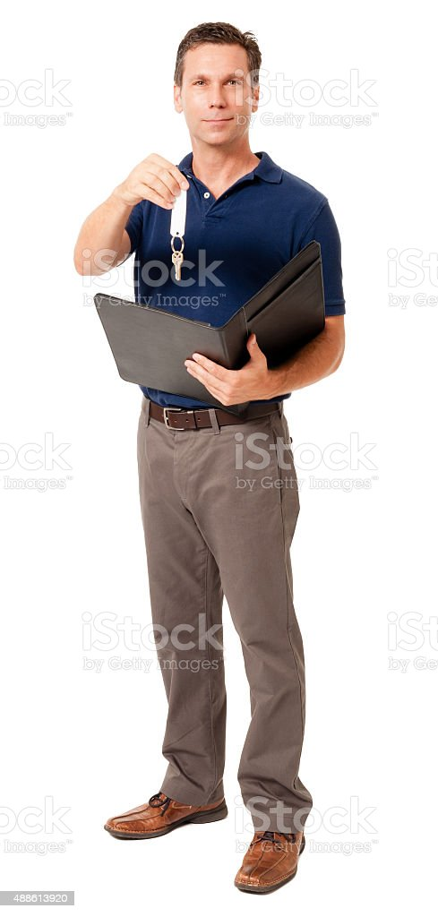 Causal businessman with hourse keyes on white stock photo