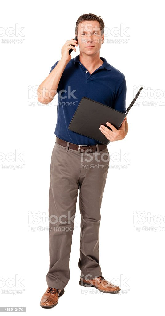 Causal businessman with mobile phone on white stock photo